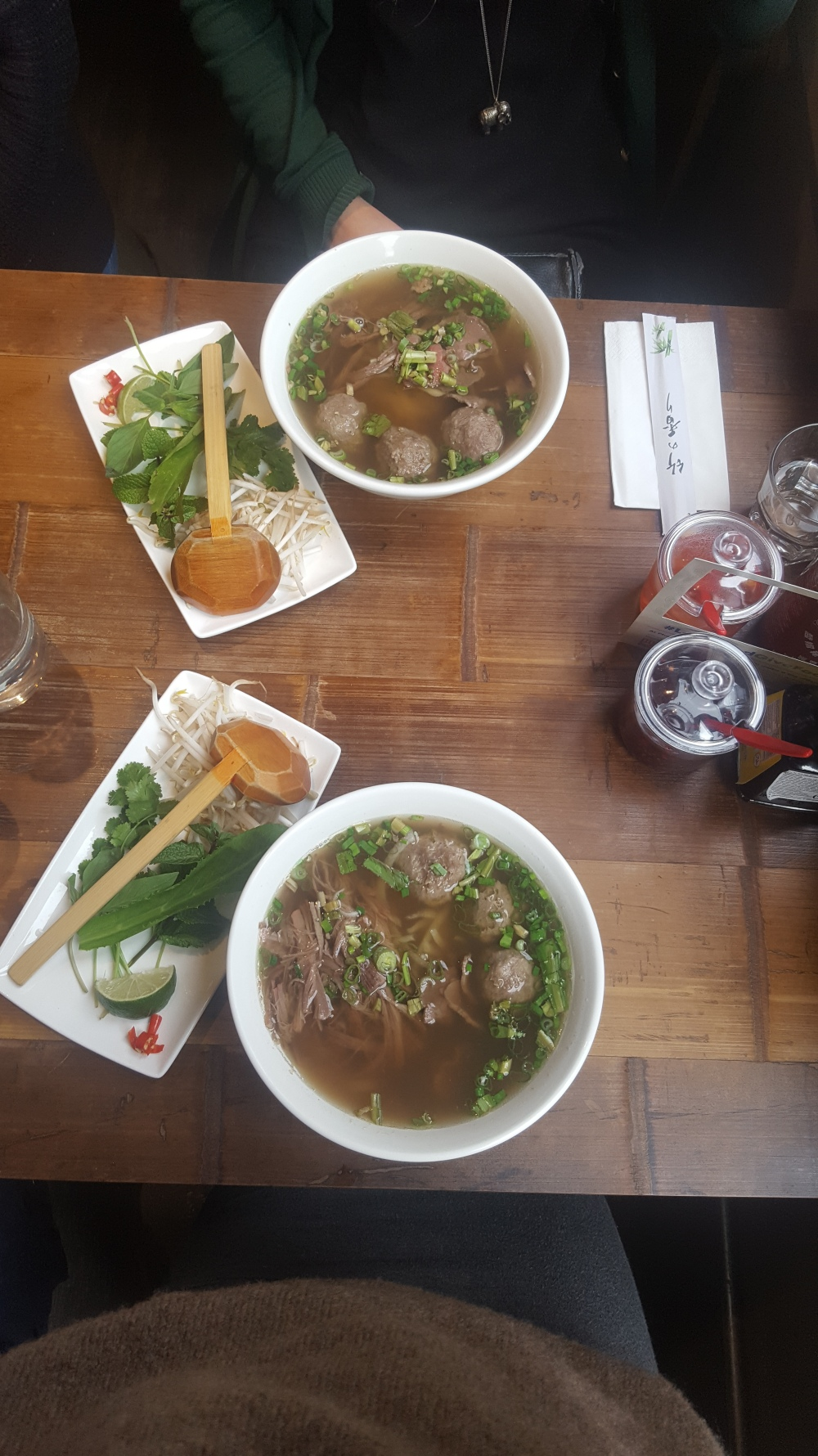 Two bowls of meat pho from above