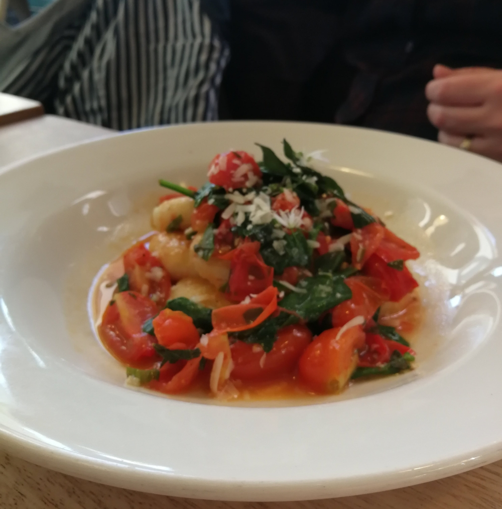 Knedle dumplings with wild garlic butter, tomatoes and basil