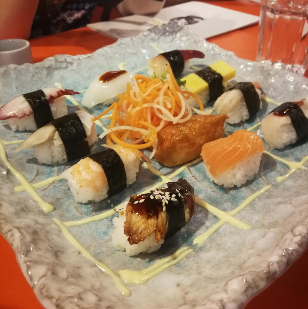 Square plate with a variety of sushi options
