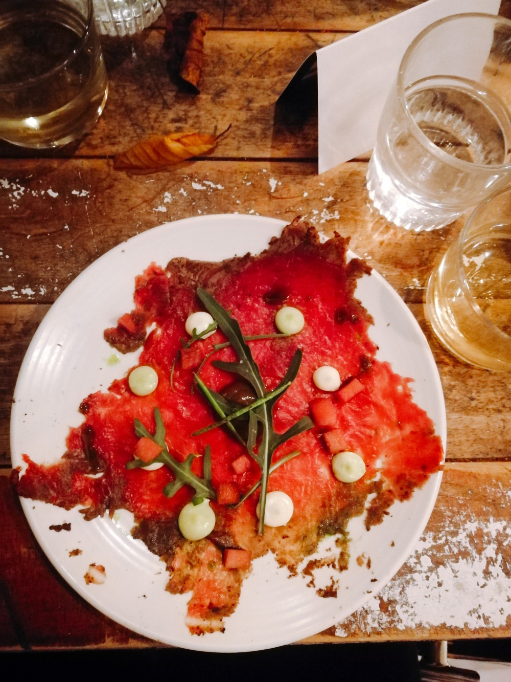 Venison carpaccio - photo taken from above showing rustic table