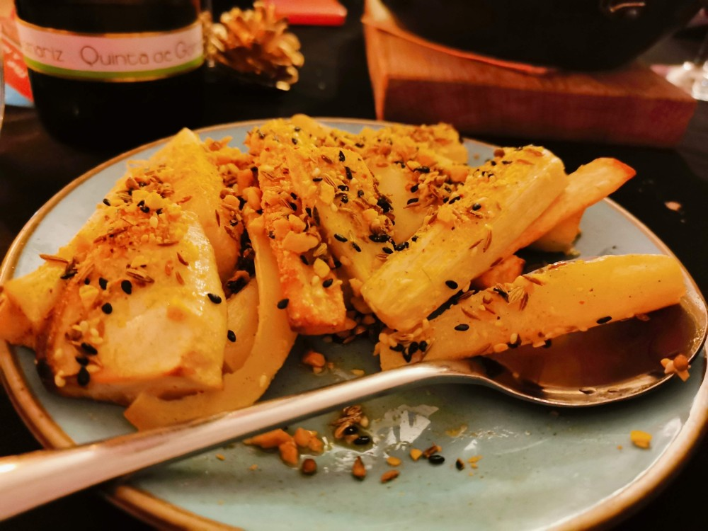 Plate of roasted parsnips topped with dukkah