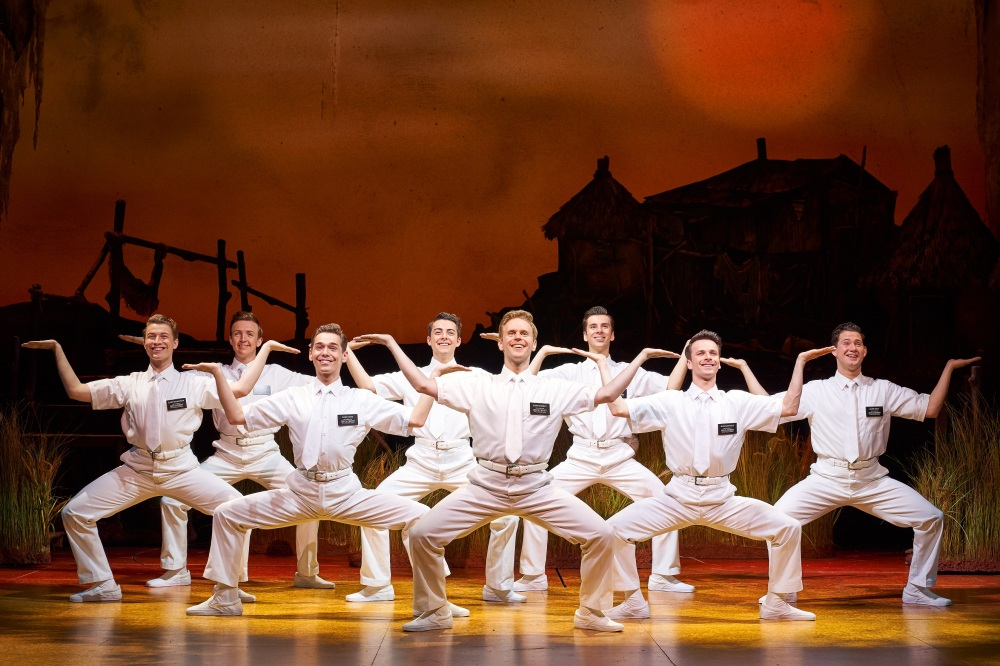Company of The Book of Mormon: Men dressed in white dancing